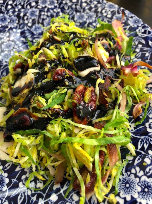Shredded Brussels sprout salad with walnuts and a balsamic dressing.