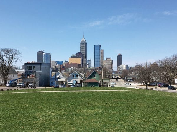 A green park overlooks downtown Indianapolis